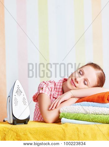 Tired Housewife Fell Asleep On Ironing Board With Iron
