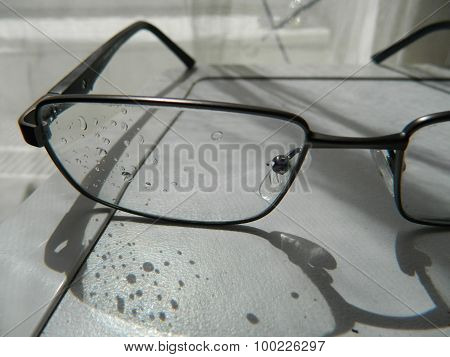 Eyeglasses With Drops Of Water.