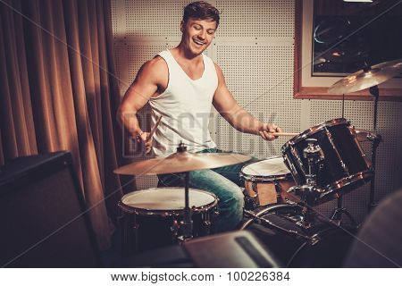 Man behind drums on a rehearsal