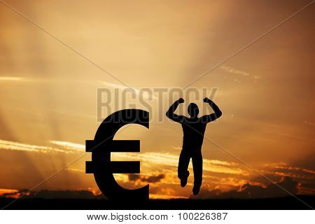 Happy man jumping for joy next to EURO symbol. Winner of lottery, financial business success concept