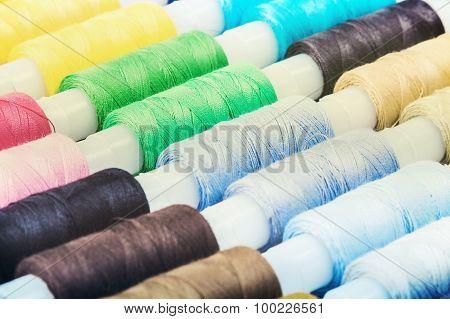 Multicolor Bobbin Threads On Background