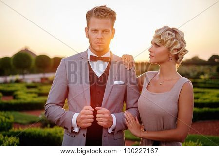 Well-dressed couple in a beautiful park