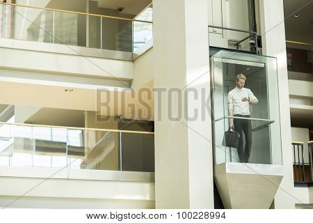 Young Businessman In The Elevator