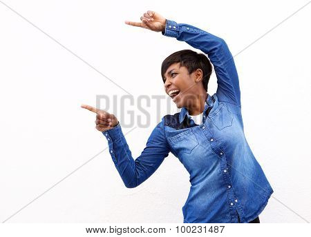 Cheerful Young African American Woman Pointing Fingers