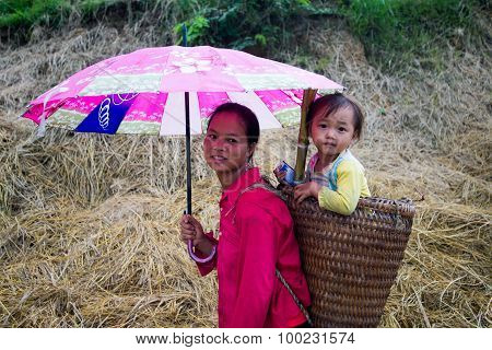 H'Mong ethnic minority woman with her child in basket