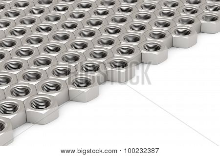 Array Of Silver Machine Nuts In A Symmetrical Pattern