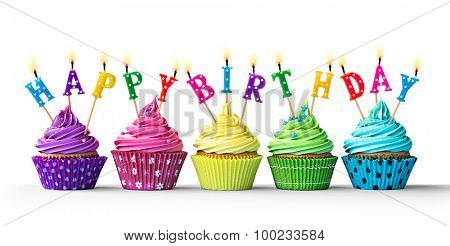 Row of colorful birthday cupcakes isolated on a white background