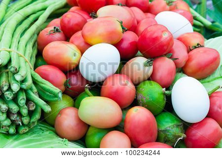 Tomatoes, beans, eggs on the counter market.