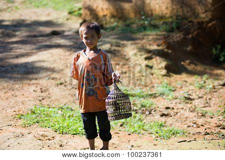 An ethnic minority child play with his bird in Laocai, Vietnam