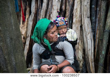Hani (Ha nhi) ethnic minority woman with her child