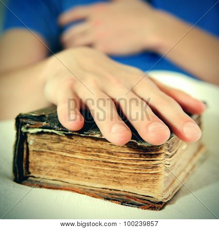 Hand On The Old Book