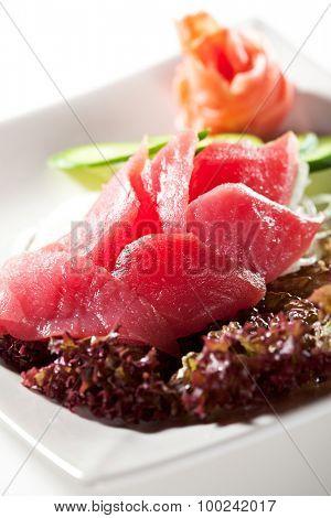 Tuna Sashimi - Sliced Raw Tuna on Daikon with Seaweed and Cucumber