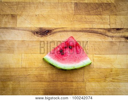 Watermelon slice arranged on a wooden board