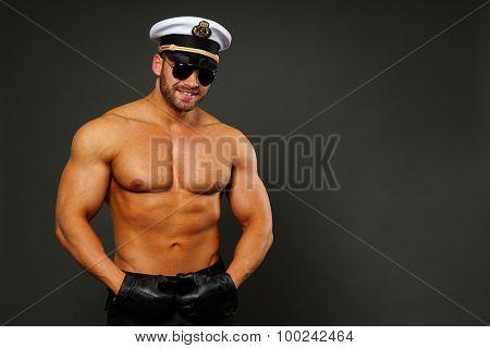 Muscular man in captain cap