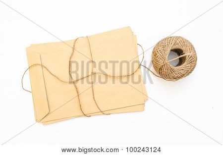 old brown envelope isolated with skein of twine