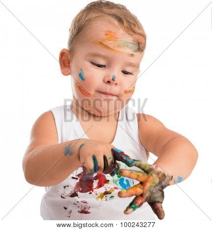 funny little boy painting his hands isolated on white background