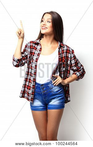 Advertisement Concept - Attractive Young Woman In Casual Clothes Pointing Her Finger Up