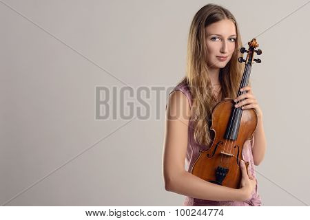 Attractive Young Musician Holding Her Violin