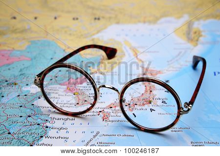 Glasses on a map of Asia - Tokyo