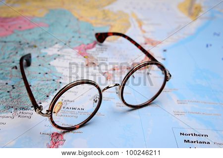 Glasses on a map of Asia - Taiwan