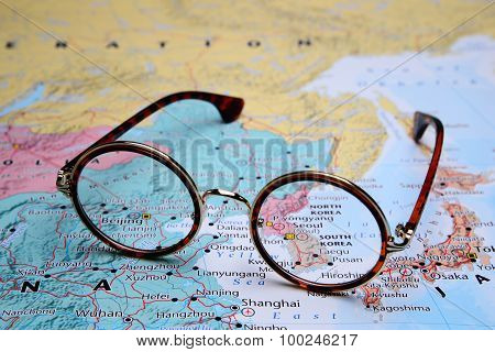 Glasses on a map of Asia - Seoul