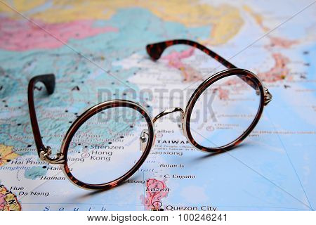 Glasses on a map of Asia - Hong Kong