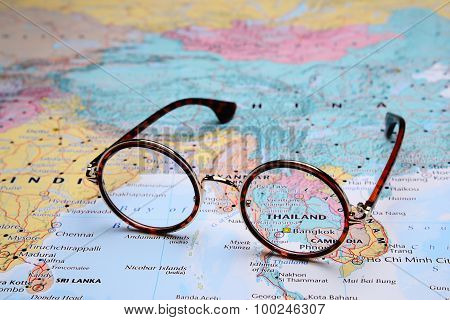 Glasses on a map of Asia - Bangkok