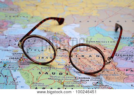 Glasses on a map of Asia - Iran