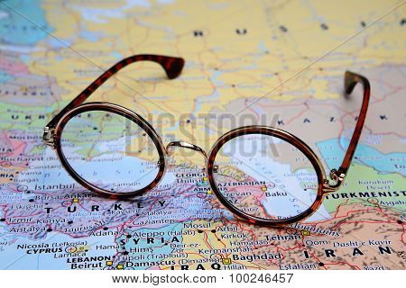 Glasses on a map of Asia - Baku