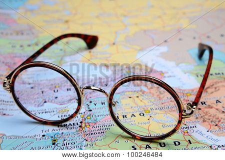Glasses on a map of Asia - Iraq