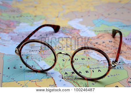 Glasses on a map of Asia - Riyadh