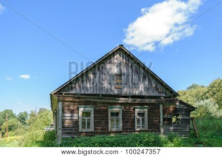 Old Dilapidated Abandoned Wooden House On Forest Clearing