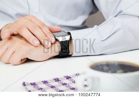 Businessman Working With Smart Watch In Restaurant