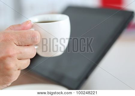 Female Hands Holding Black Tablet Pc