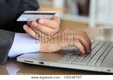 Hands Of Businessman In Suit Holding Credit Card