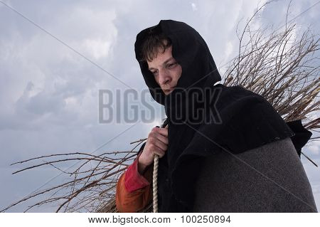 Medieval Peasant With A Bundle Of Firewood