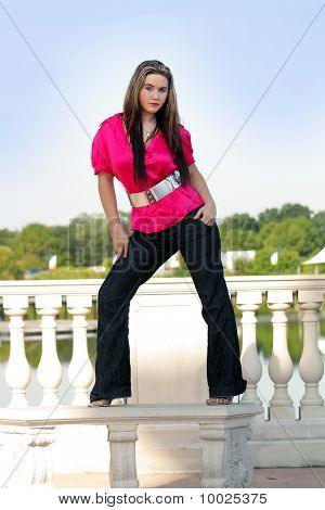 Beautiful Teen Girl Standing on an Outdoor Bench