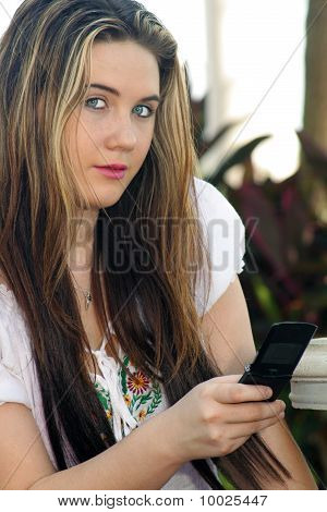 Beautiful Teen Girl Texting Outdoors