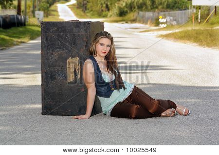 Teen Girl with a Trunk in the Street