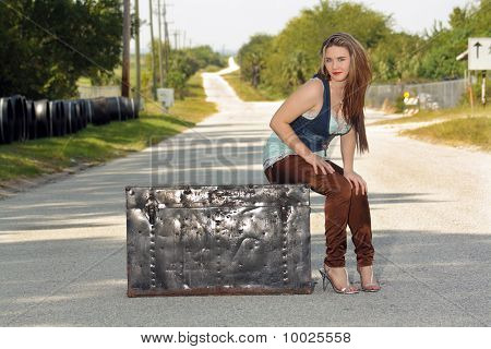 Teen Girl on a Trunk in the Street (4)