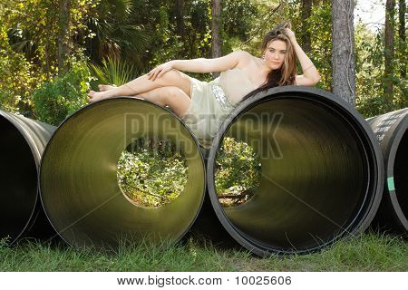 Beautiful Teen Girl Lying on a Large Pipe