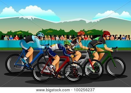 People Cycling In The Competition