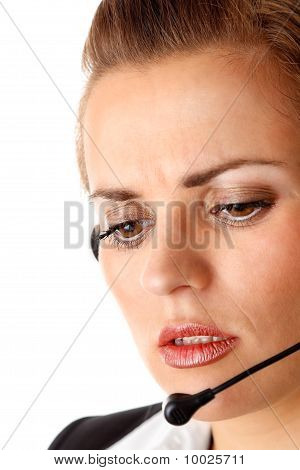 worried modern business woman with headset