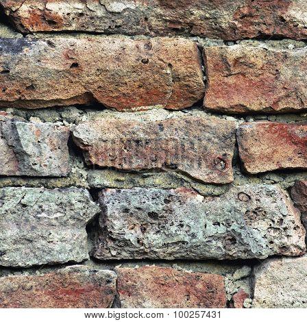 Stone Wall Macro Closeup, Stonewall Pattern Background, Old Aged Weathered Red Grey Grunge Limestone