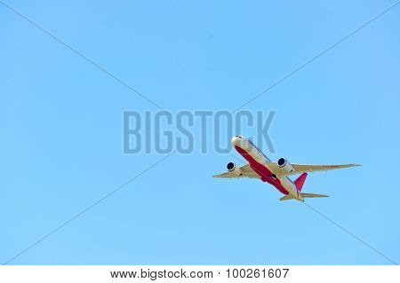 HONG KONG - APRIL 15, 2015: Air India Boeing 787 take-off. The Boeing 787 Dreamliner is a long-range, mid-size wide-body, twin-engine jet airliner developed by Boeing Commercial Airplanes