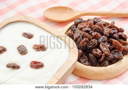 Home Sweet Yogurt With Raisins In A Wooden Bowl On Fabric Background.
