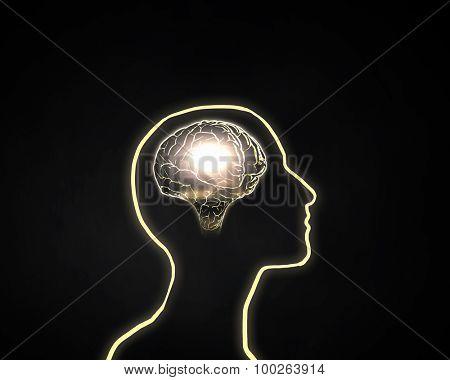 Human head silhoutte and glowing brain inside