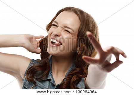 Winking girl shows gesture of victory hand