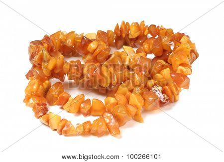 Beads of precious stones on a white background