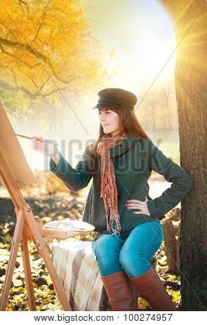 The Young  Woman Draws A Landscape In Nature
